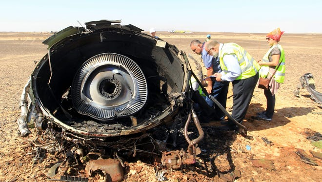 Egyptian investigators check debris from a crashed Russian charter jet in Sinai, Egypt, Nov. 1, 2015, which crashed in the largely desert peninsula killing all 224 people aboard.