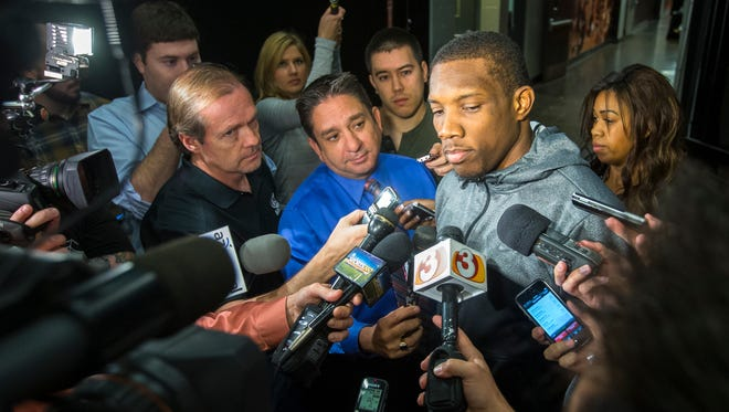 Suns point guard Eric Bledsoe talks with the media after he cleared out his US Airways Center locker at the end of the season on Thursday, April 17, 2014.