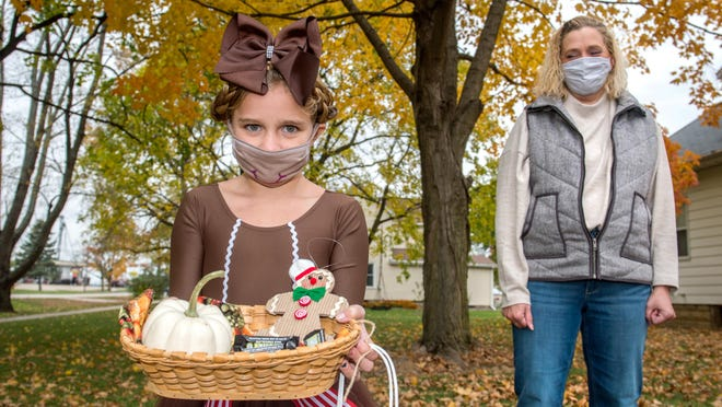 Lori Grooms, director of infection prevention for OSF HealthCare, is changing the way her 9-year-old daughter Lydia will be participating in trick-or-treating on Halloween night.