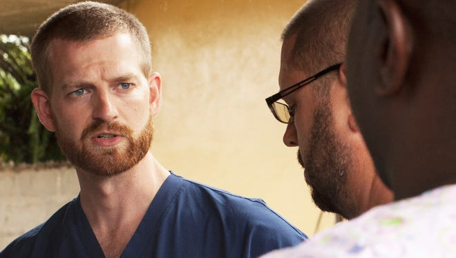 Dr. Kent Brantly, left, one of the two Americans who contracted the deadly Ebola virus, in Africa was released from a U.S. hospital on Aug. 21, 2014.
