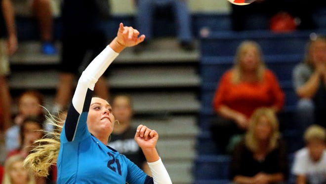 Siegel's Leah Poarch (21) hit the ball over the net during the winners finals round of the TSSAA Class AAA state volleyball tournament against Brentwood, on Thursday, Oct. 22, 2015, at Blackman.
