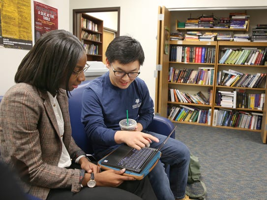 Raymond Yu, a third-year Optics major, right, goes over a project with Jazmyn Haywood, academic advisor, at the David T. Kearns Center for Leadership and Diversity in Arts, Sciences, and Engineering at the University of Rochester Wednesday, Feb. 14, 2018.