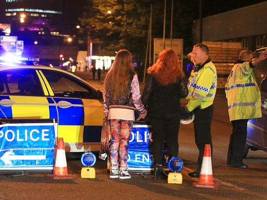 Police work at Manchester Arena after reports of an