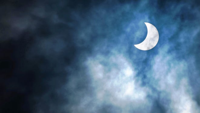 A partial solar eclipse is seen in the sky of Dar es Salaam, Tanzania.