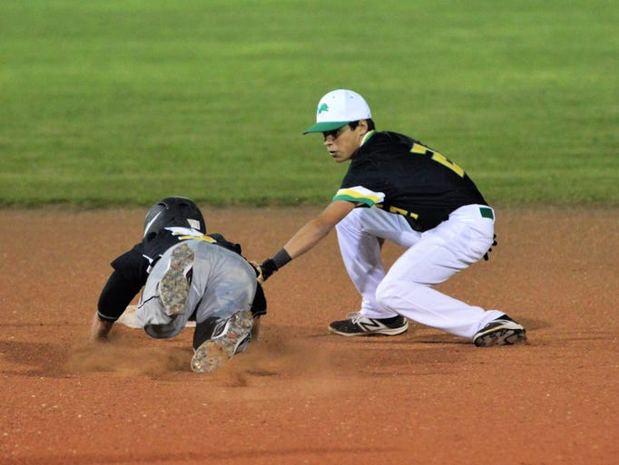 Dublin's Tim Teten (right) applies a tag to Cisco's