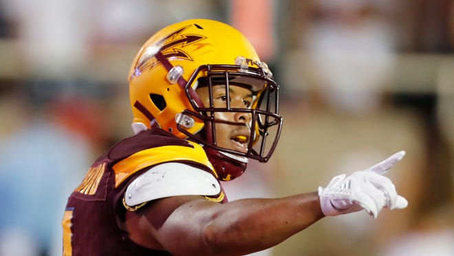 Arizona State's Demario Richard celebrates a first-half touchdown against Texas Tech during an NCAA college football game Saturday, Sept. 16, 2017, in Lubbock, Texas.