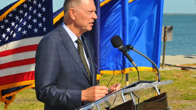 U.S. Bill Posey addresses the audience at a  memorial dedication ceremony at Patrick Air Force Base.