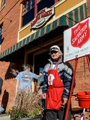 Charlie Behrens mans the Salvation Army red kettle