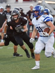 Lakeland's Robbie Tracy (21) finds an opening pursued