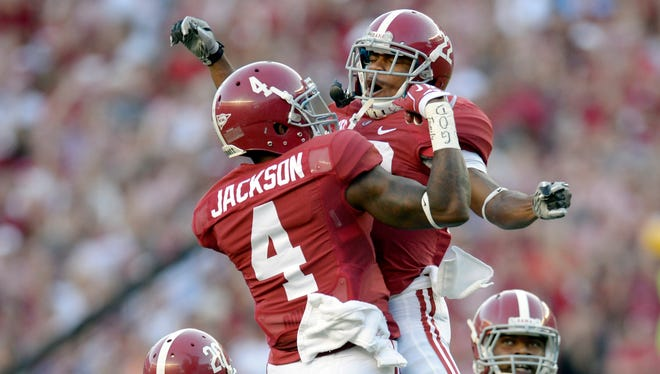 Alabama defensive back Eddie Jackson (4) celebrates his interception with wide receiver Christion Jones (22) during the first quarter of the Crimson Tide's win Saturday at Bryant-Denny Stadium.