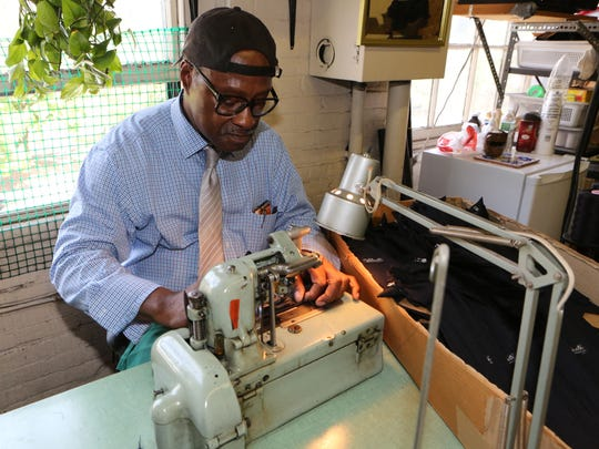 Albert Valentine, Jr. the owner of Valenti Neckwear Company in Yonkers, makes button holes in the clip-on ties he manufactures for law enforcement, at his shop in the SoYo Arts Building in Yonkers, July 28, 2016.