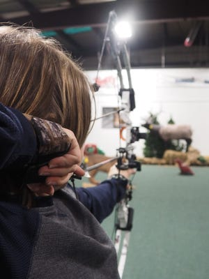 A student draws his bow at Tuffy's Outpost in Fond du Lac. There are a variety of opportunities for youth interested in archery within Fond du Lac County.