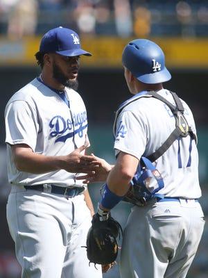 Dodgers' Kenley Jansen  celebrates with catcher A.J. Ellis after the win.