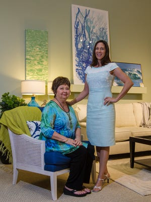 From left, Jinx McDonald, interior designer and president of Jinx McDonald Interior Designs Inc, and her daughter Minka McDonald, communications director, pose for a portrait at their showroom in Naples.