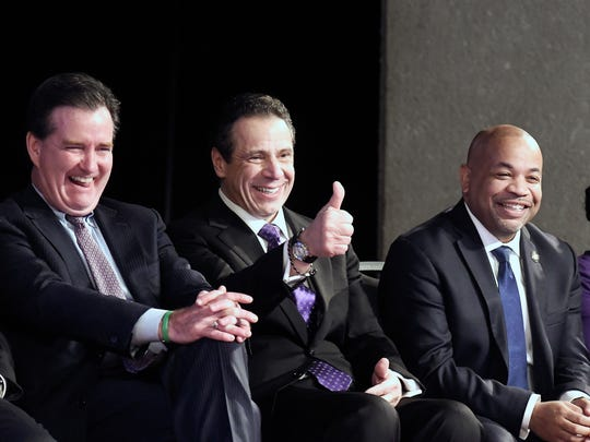 New York Gov. Andrew Cuomo, center, is flanked by Senate Majority Leader John Flanagan, R-Smithtown, left, and Assembly Speaker Carl Heastie, D-Bronx, right, as he wits to deliver his State of the State address at the Empire State Plaza Convention Center on Wednesday, Jan. 3, 2018, in Albany, N.Y.