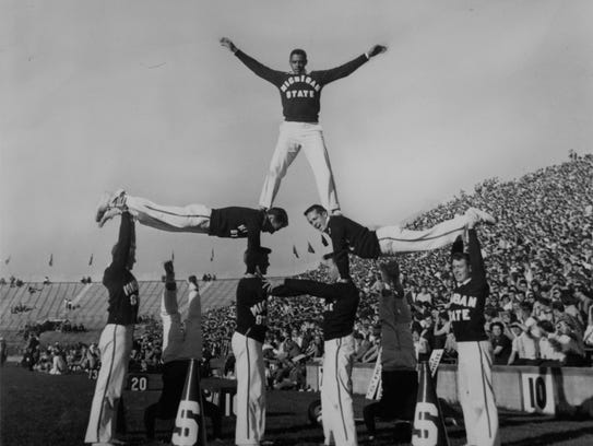 Don Vest, MSU's first black cheerleader, at the top
