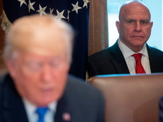 "National Security Adviser H.R. McMaster alongside US President Donald Trump as he holds a Cabinet Meeting in the Cabinet Room at the White House in Washington, DC, December 20, 2017. US President Donald Trump on Wednesday hailed the imminent adoption of a sweeping Republican tax cut plan as a ""victory"" for the country.  / AFP PHOTO / SAUL LOEB        (Photo credit should read SAUL LOEB/AFP/Getty Images)"