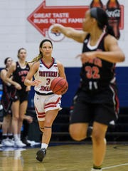 USI's Randa Harshbarger (3) dribbles down court during