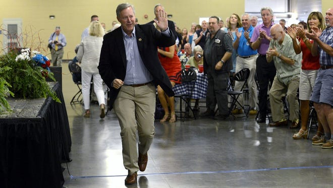 Eleventh District U.S. Rep. Mark Meadows waves as he approaches the podium at a June rally in Fletcher.