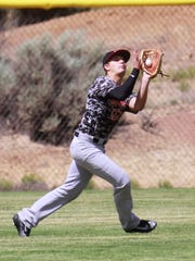 Naa'taanii outfielder Cadan Flack makes a catch in the outfield against Strike Zone on Monday at Piedra Vista High School in Farmington.