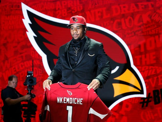 Mississippi's Robert Nkemdiche poses for photos after being selected by the Arizona Cardinals as the 29th pick in the first round of the 2016 NFL football draft, Thursday, April 28, 2016, in Chicago. (AP Photo/Charles Rex Arbogast)