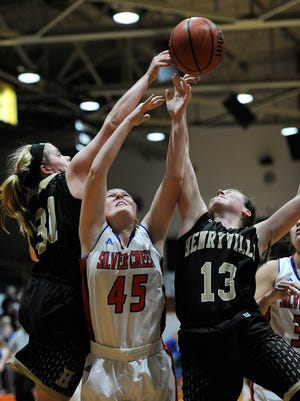 Silver Creek's Abby Whitlock (45) battles for a rebound against Henryville's Hannah Nunn (31) and Reagan Hensley (13) on Tuesday at Silver Creek High School. (Photo by David Lee Hartlage, Special to The Courier-Journal) Dec. 13, 2016