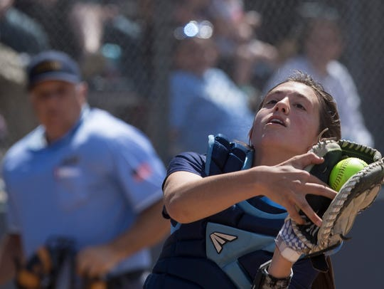 IHA's Mia Recenello pulls in a pop-up during late innings