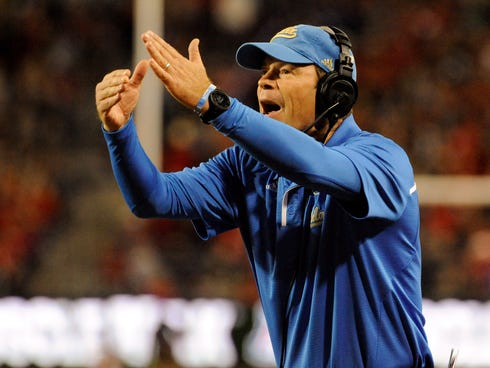 UCLA Bruins coach Jim Mora calls a time out during the second quarter against the Arizona Wildcats.