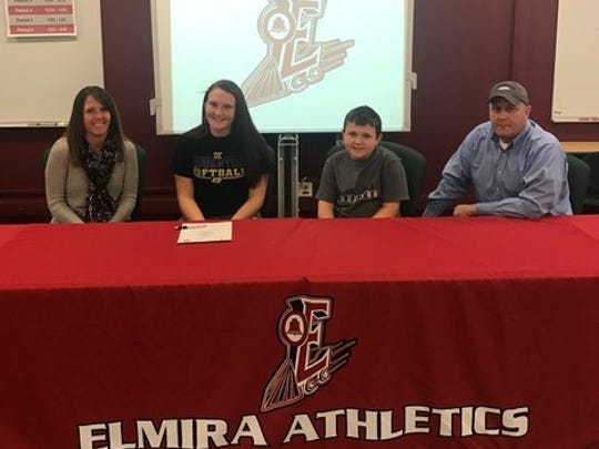 Elmira's Ally Bar, second from left, is joined by family members at her signing Monday at Elmira High School.
