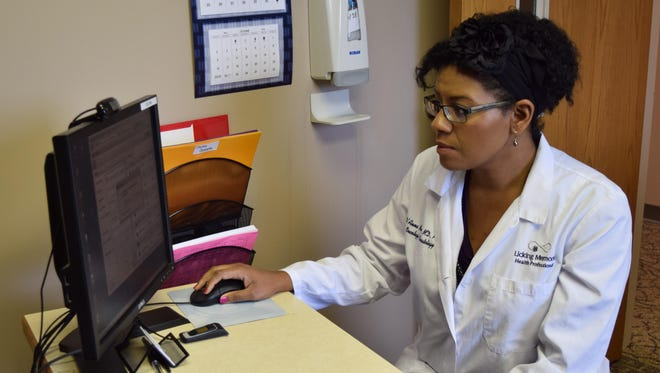 Dr. D'Anna Mullins, an oncologist and hematologist for Licking Memorial Hospital, searches for a patient's record in the system.