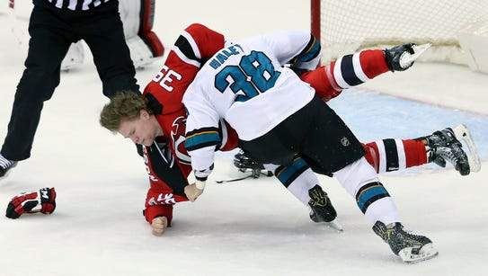 San Jose Sharks center Michael Haley (38) fights with