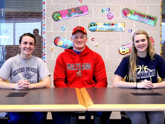 Three student athletes from Spring Grove Area High School recently signed letters of intent to play college sports. They are, from left: Morgan Arden, attending Sheppard University, David Shaw, attending University of Maryland, and Brooke Osborne, attending University of Pittsburgh Bradford. (SUBMITTED)