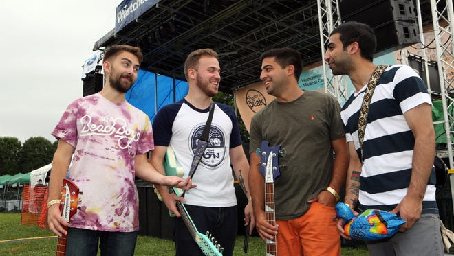 The band Indigo King, from left, Liam Houghtaling, Josh Braunstein, Danny Annibale and Faiz Lone chat in front of the Tri-State Ford Main Stage during the 12th annual Pleasantville Music Festival July 9, 2016.
