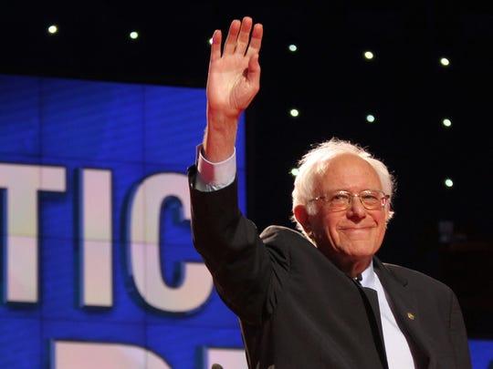 Bernie Sanders greets the crowd during the Democratic debate against Hillary Clinton at Brooklyn Navy Yard in Brooklyn on April 14, 2016.