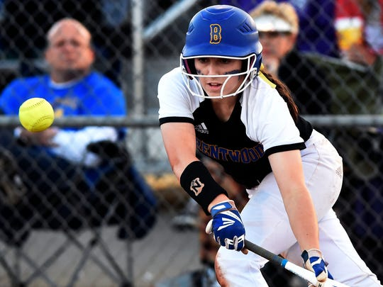 Brentwood's Elisabeth Laviolette bunts for a base hit against  Brighton during the third inning of an Division I AAA state softball first-round game Wednesday, May 24, 2017, in Murfreesboro, Tenn. Brentwood won 5-0.