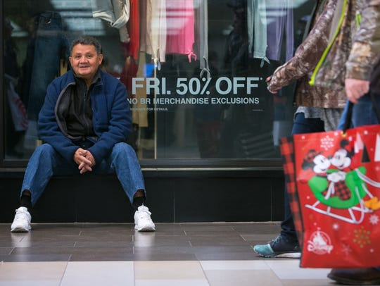 A shopper from New York takes a break early Black Friday