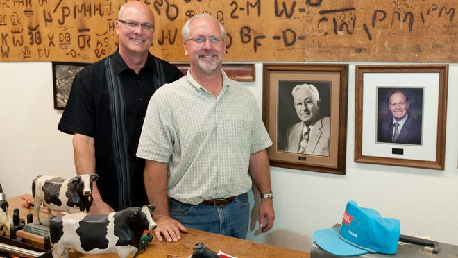 Brothers Charles Sybesma, left, and Arnold Sybesma pose   May 15 at The Heritage Complex with a donation for the Antique Farm Equipment Museum.