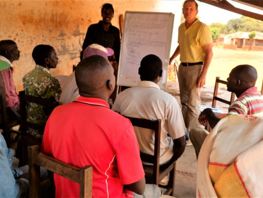 Ronald Overmyer teaches Mozambique farmers during his