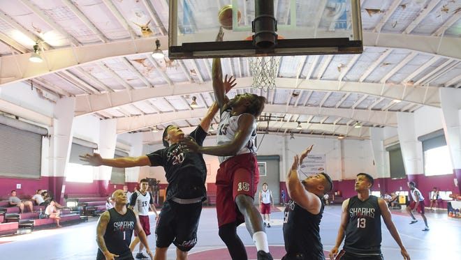 The Tamuning Typhoons' Rodrigue Ebondo attempts a reverse layup off the glass against the Sanchez Sharks in the 2017 Holiday TipOFF at the Tamuning Gym on Dec. 30. The 2019 Holiday TipOFF starts Dec. 15 at Tamuning Gym.