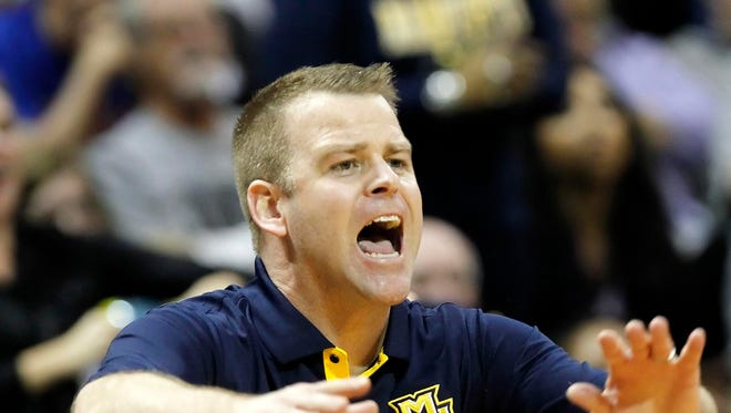 Marquette Golden Eagles head coach Steve Wojciechowski reacts against the Georgia Tech Yellow Jackets during the first half at HP Field House.