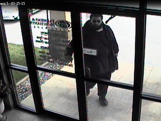 Farmers & Merchants State Bank in St. Charles captured security camera stills of the armed robbery suspect.