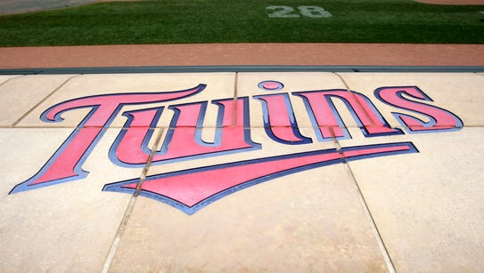 The Twins' logo is displayed on the Twins dugout at