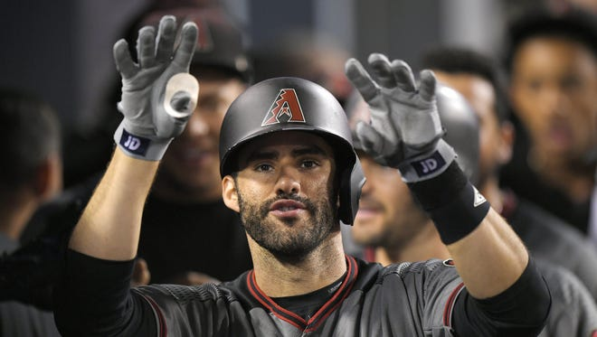 J.D. Martinez gestures toward the camera after hitting his fourth home run of the night against the Dodgers on Sept. 4.