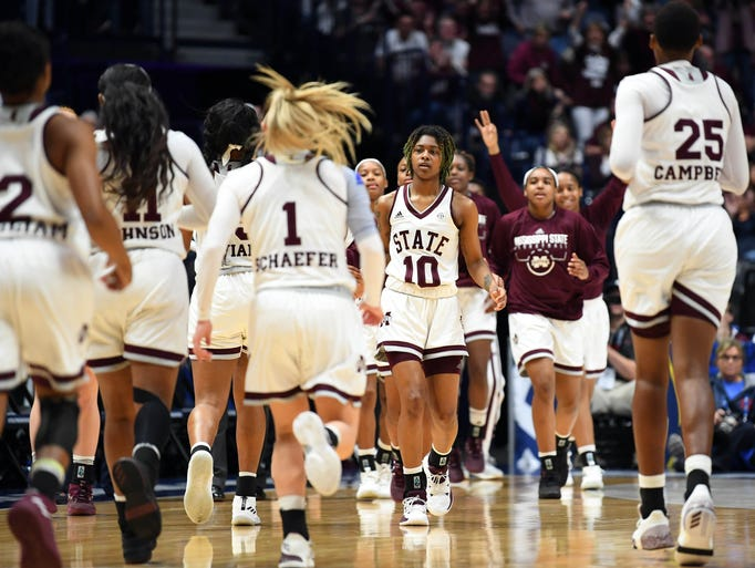 Mississippi State Lady Bulldogs players celebrate against
