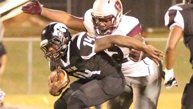 South Side running back Timothy McGowan runs with the ball during the Hawks' 28-22 win over Liberty on Oct. 6, 2017.