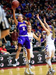 Johnston's Maya McDermott puts up a shot in the 5A Girls State quarterfinal against Indianola Wednesday, March 1, 2017.