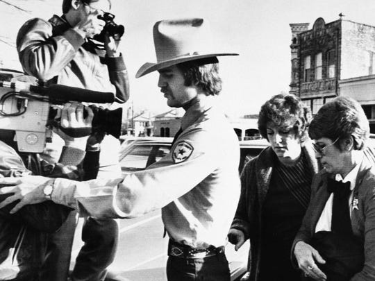 In this Feb. 16, 1984, file photo, Genene Jones, second