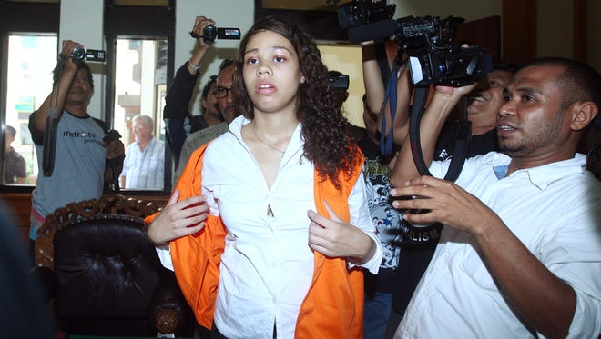 Heather Mack of Chicago, Ill., center, arrives in the courtroom for the verdict of her trial in Bali, Indonesia, Tuesday, April 21, 2015. The Denpasar District Court sentenced Tommy Schaefer to 18 years in prison and Heather Mack to 10 years for intentionally killing Sheila von Wiese-Mack while vacationing last August. The body was found in a suitcase inside the trunk of a taxi at the St. Regis Bali Resort. (AP Photo/Firdia Lisnawati)