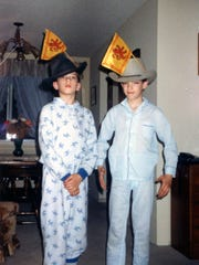 A family photo featuring Drew and Jonathan Scott as children wearing cowboy hats and pajamas. The Scott boys are also known as The Property Brothers.