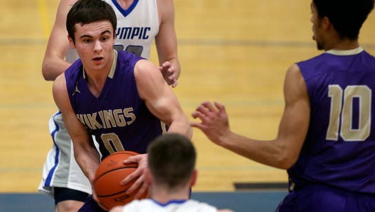 North Kitsap player Zac Olmsted gets trapped in the